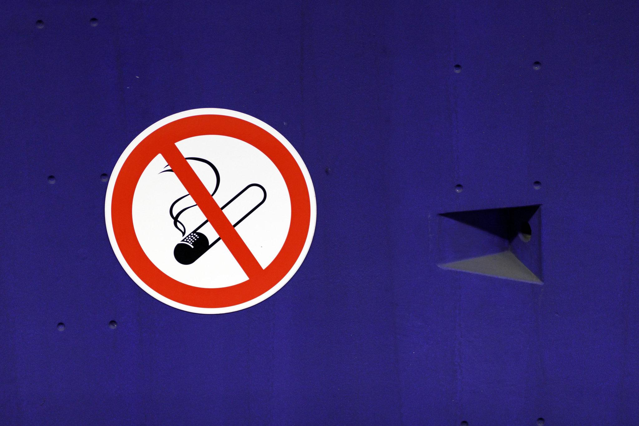 A sign indicating no smoking at a subway stop in Cologne, Germany.