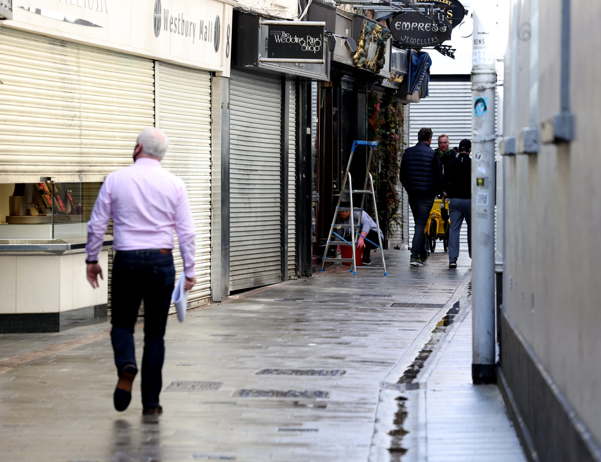 People dressing shops in Dublin City Centre ahead of re-opening