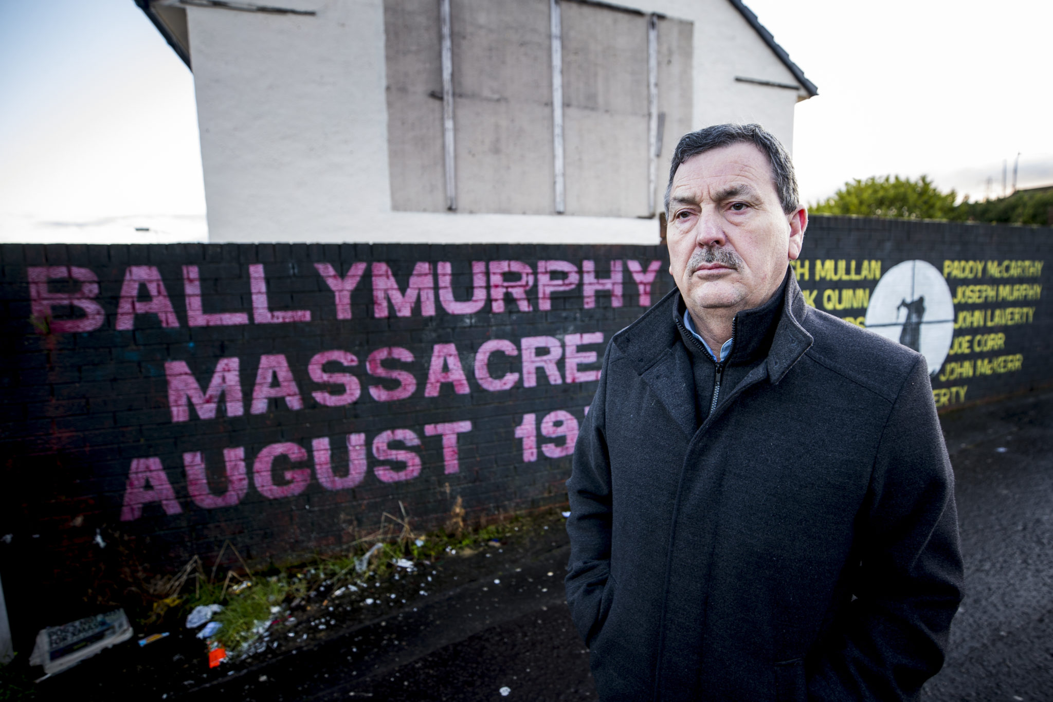 John Teggart, standing in the Ballymurphy area of west Belfast, where his father Daniel was murdered by the British Army.