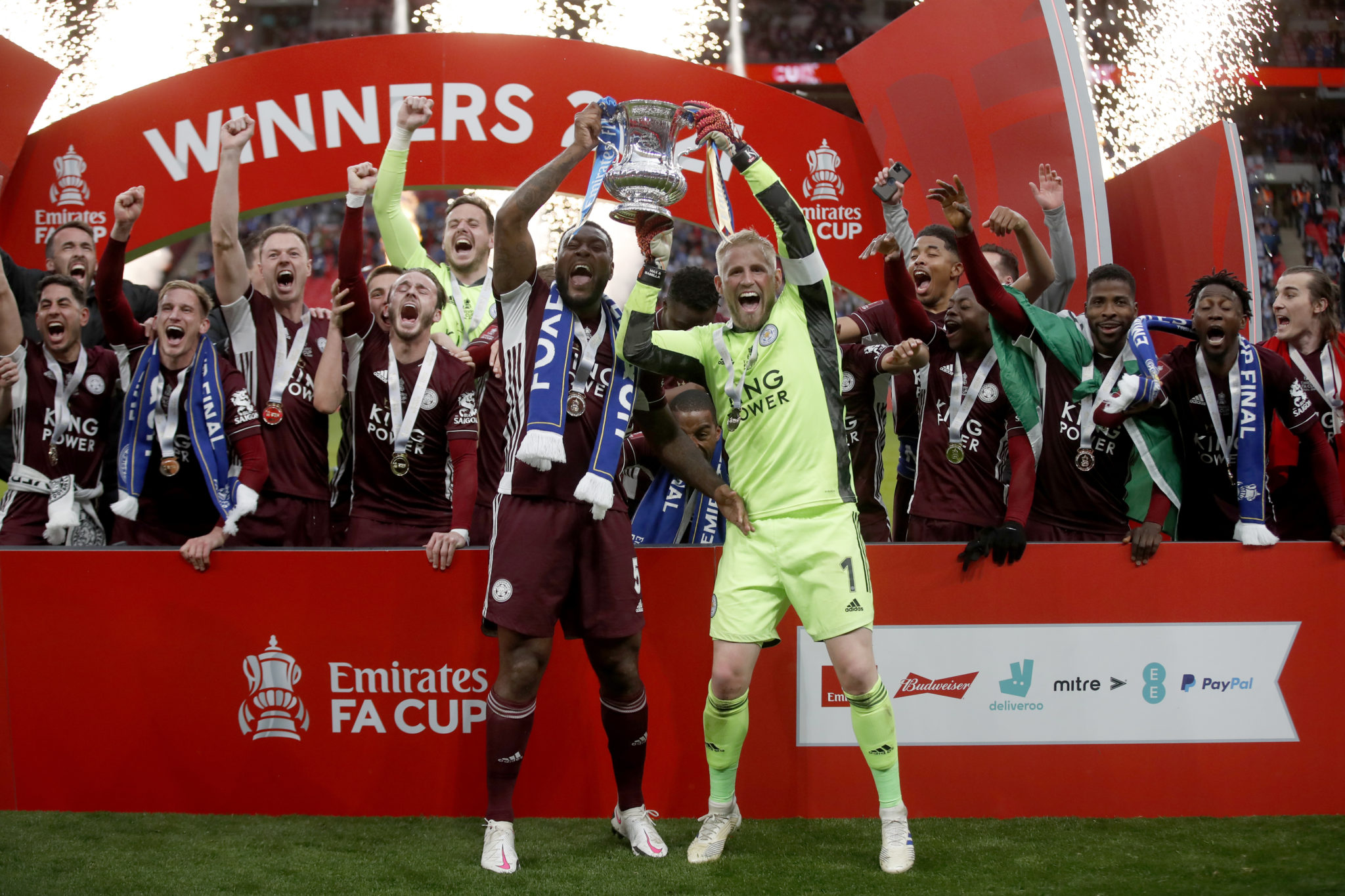 Leicester City's Wes Morgan (left) and Leicester City goalkeeper Kasper Schmeichel lift the trophy after the Emirates FA Cup Final at Wembley Stadium, London. Picture date: Saturday May 15, 2021.