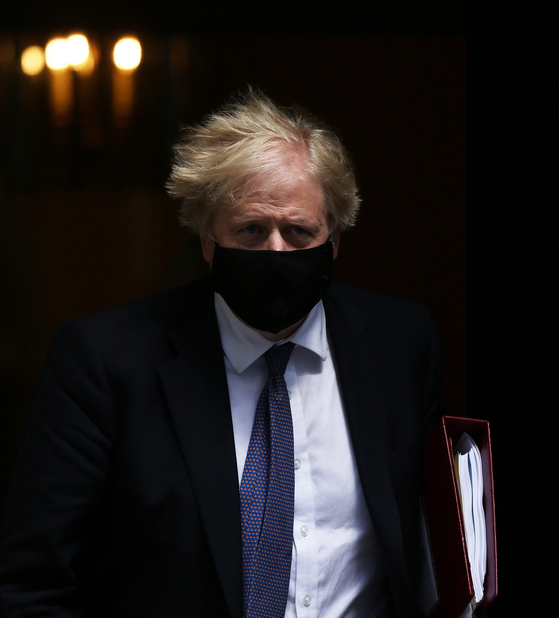 British Prime Minister Boris Johnson is seen leaving 10 Downing Street in London, England.