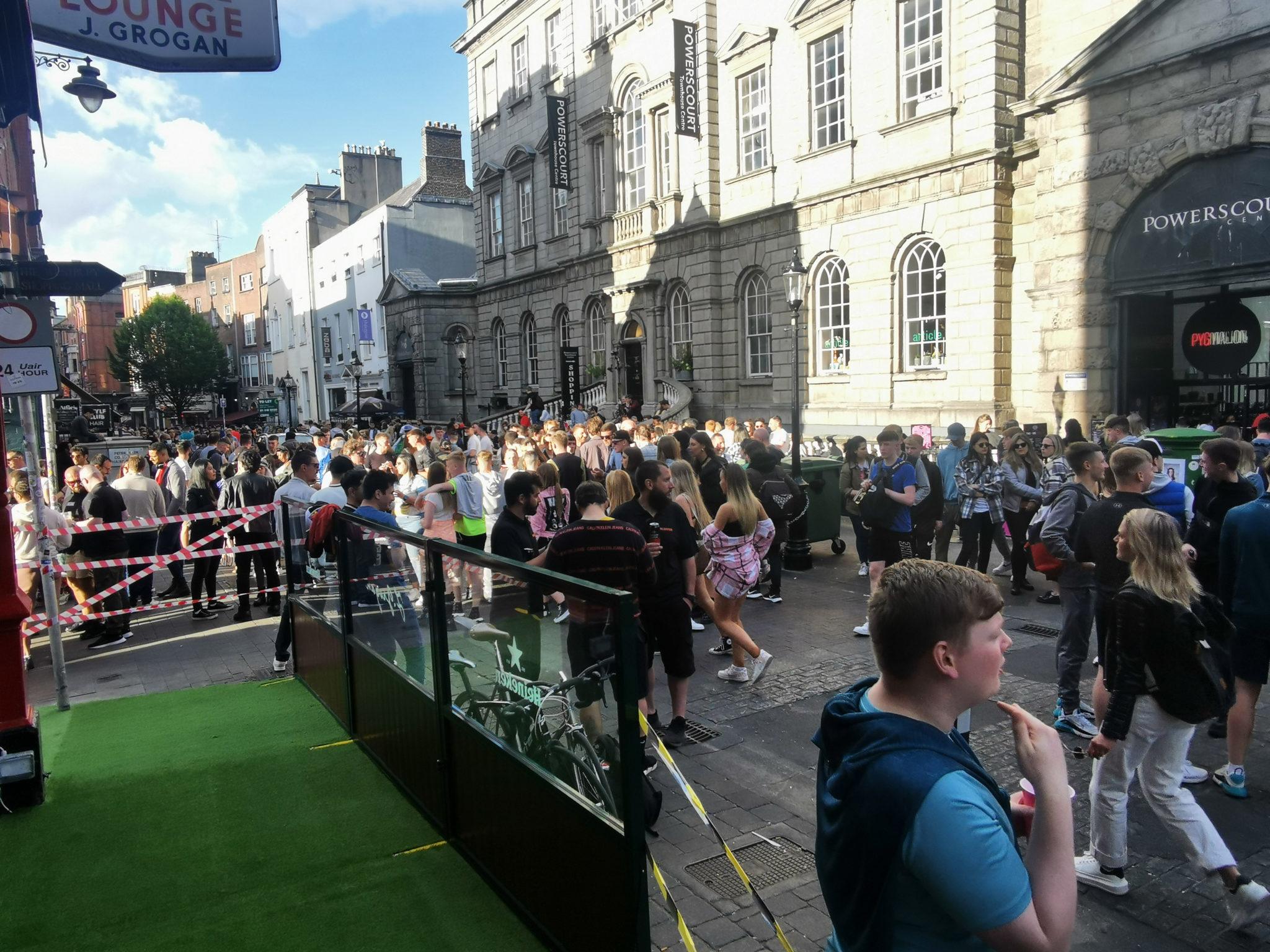 People enjoying the sunshine on South William Street this evening