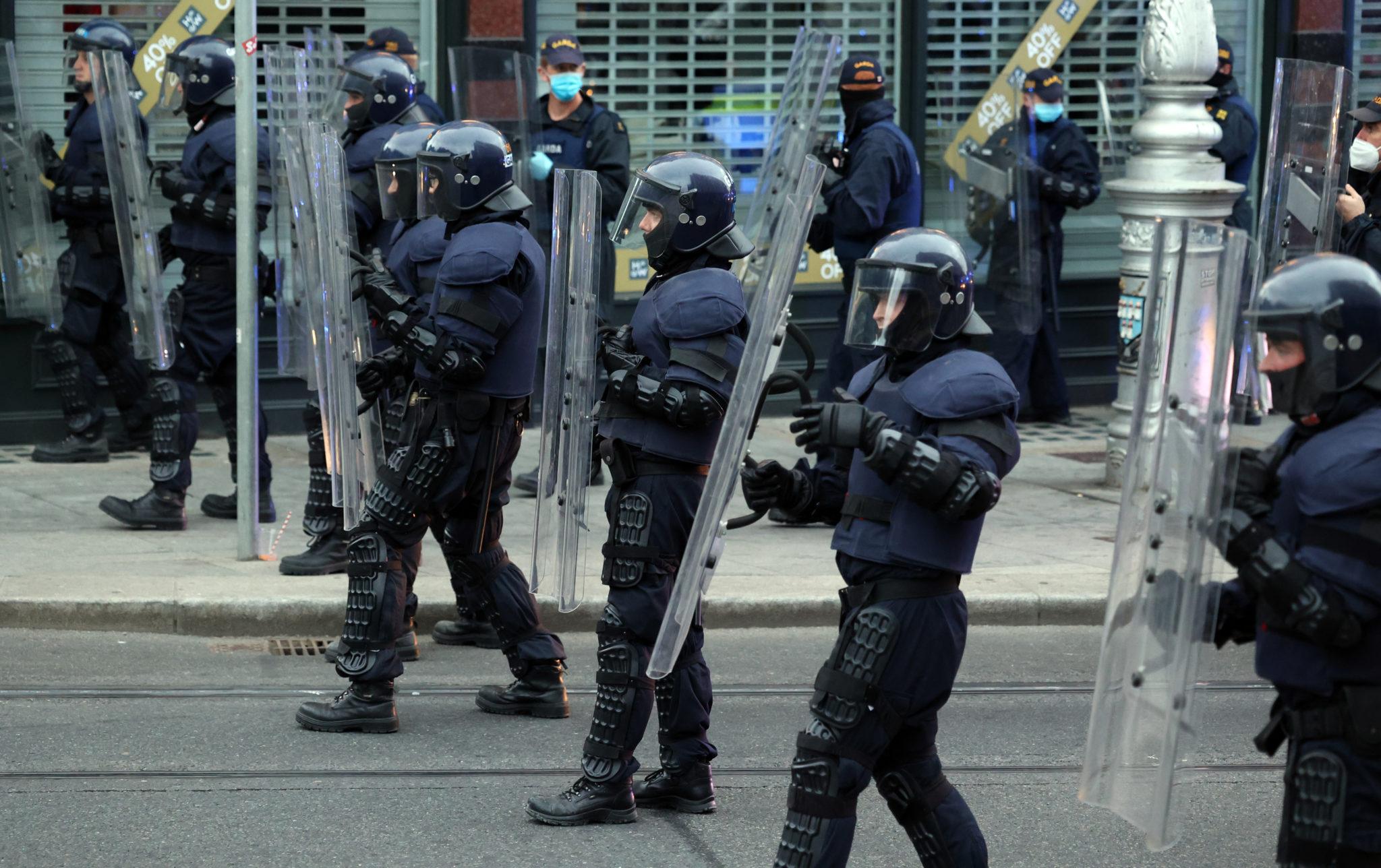 Members of the An Garda Siochana Public Order unit wearing riot gear and shields on Dawson Street in Dublin city