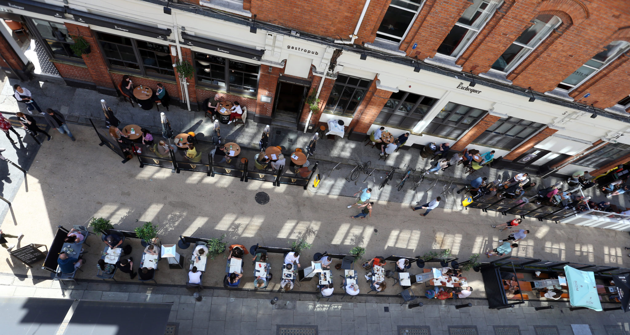 People enjoy outdoor dining on Exchequer Street in Dublin