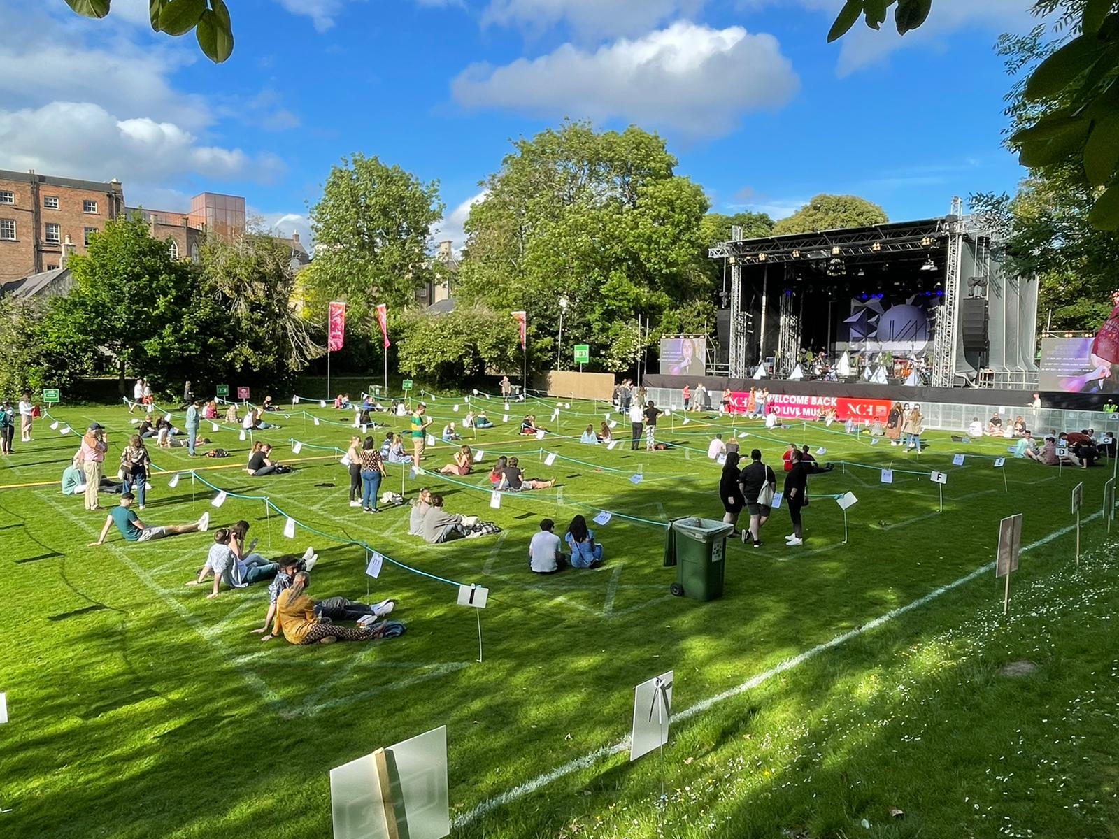 The crowd relaxes before the gig in Dublin's Iveagh Gardens
