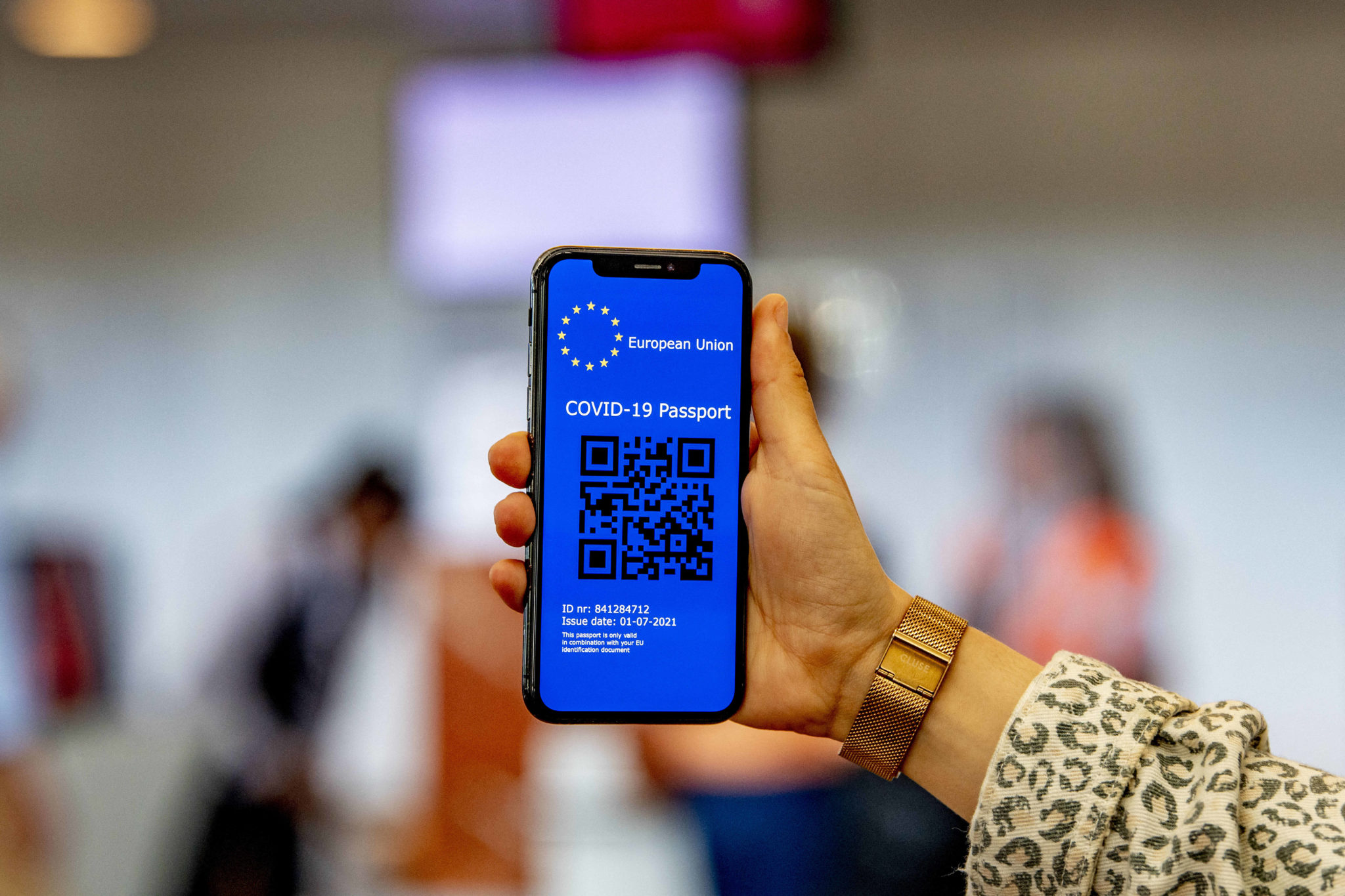 A coronavirus passport with a QR code on a mobile phone at Rotterdam Airport, Netherlands.