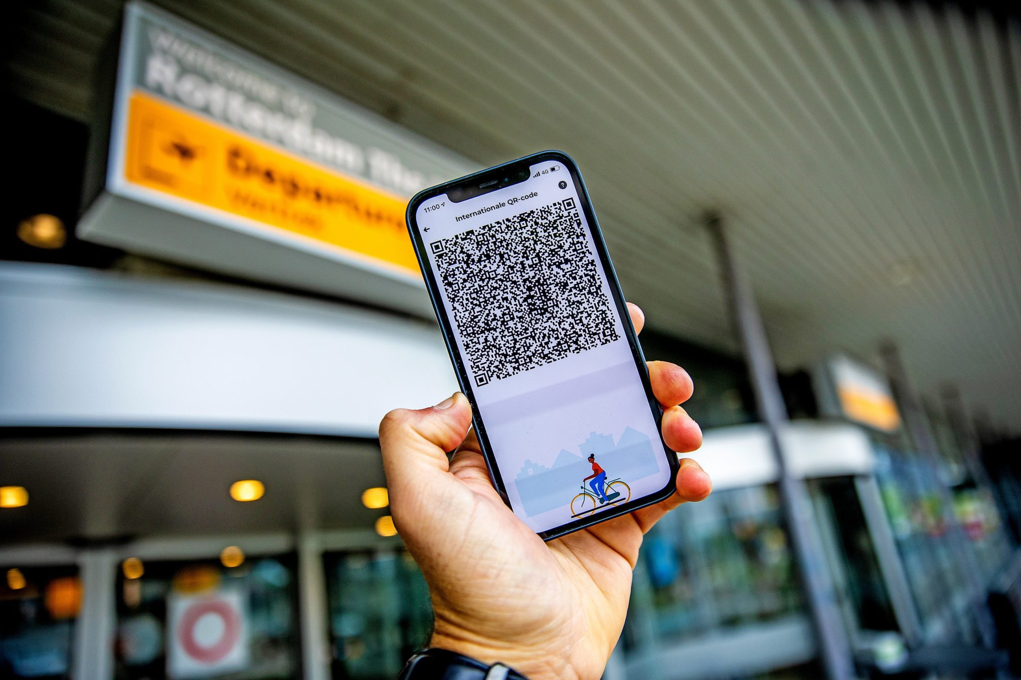 A QR code on a phone being presented in order to travel in Rotterdam, the Netherlands.