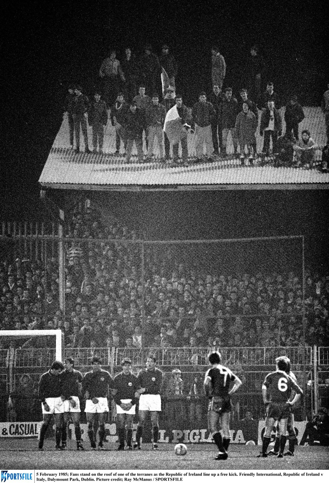 Fans stand on the roof of one of the terraces as the Republic of Ireland line up a free kick. Friendly International, Republic of Ireland v Italy, Dalymount Park, Dublin. Picture credit; Ray McManus / SPORTSFILE