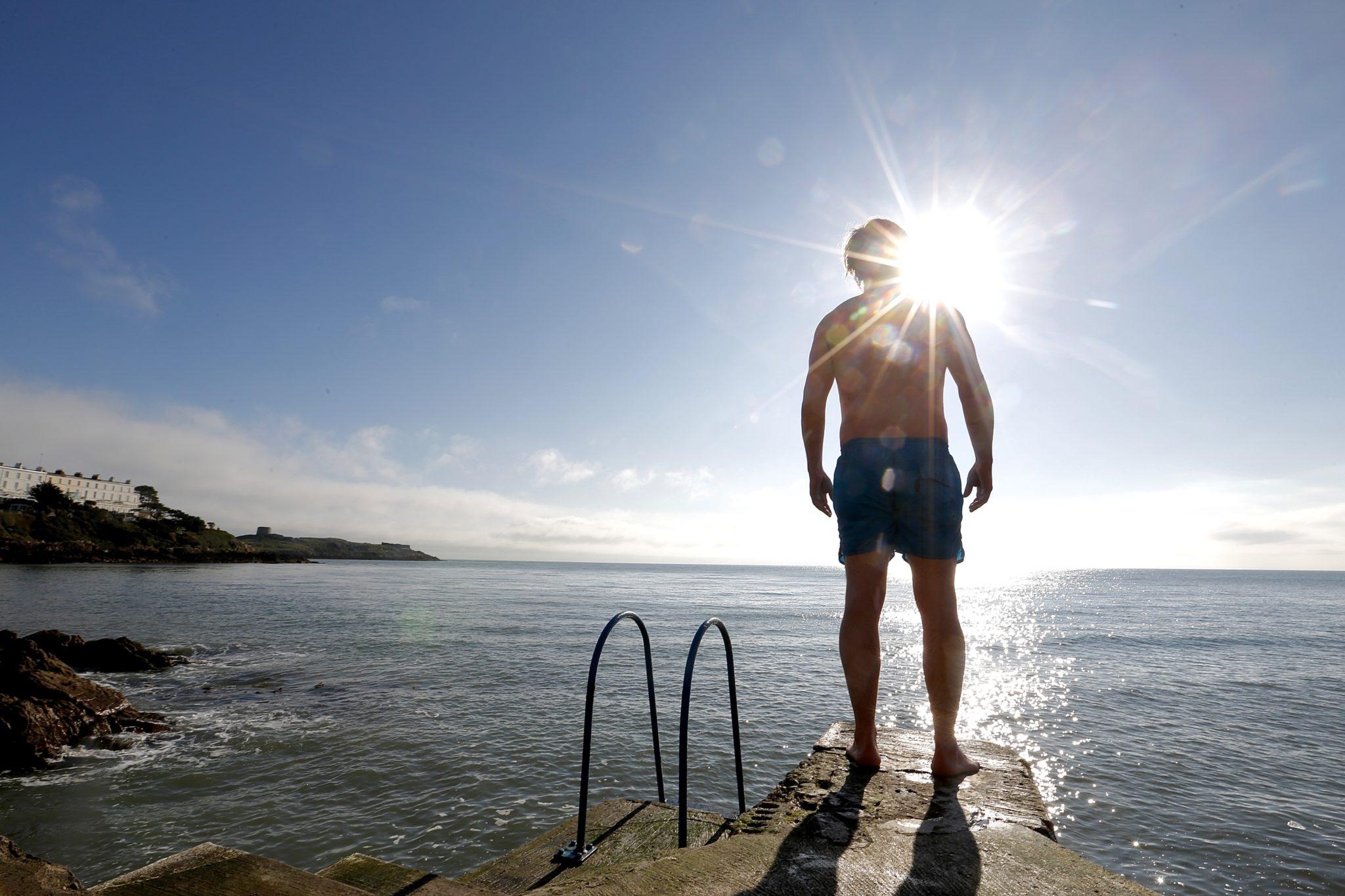 A man preparing to enter the sea at Vico Road in Dublin