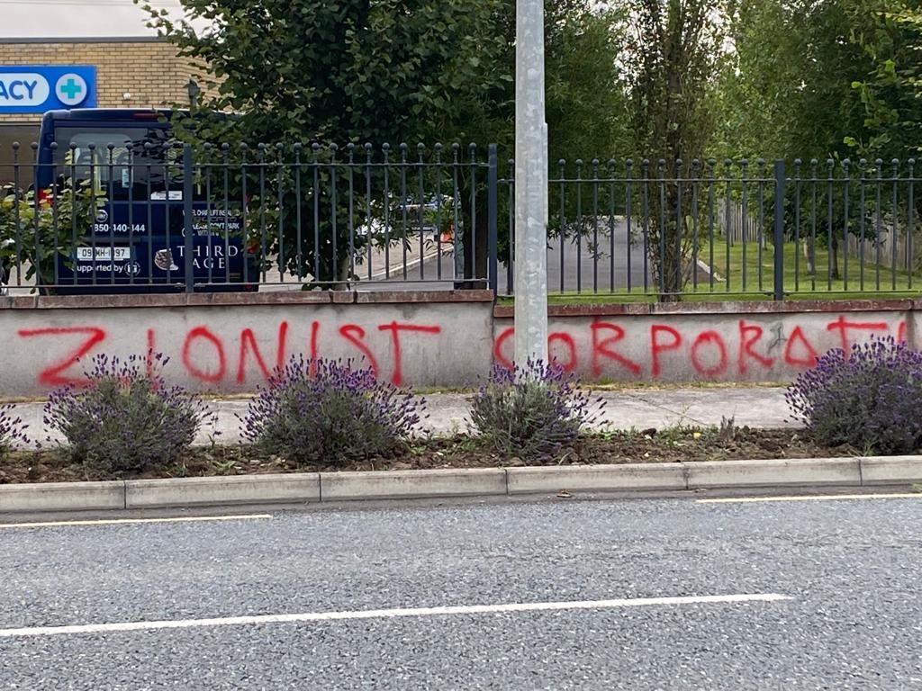 Anti-vax 'Zionist corporation' graffiti scrawled across a wall outside the Summerhill Primary Care Centre in County Meath, 28-07-2021. Image: Summerhill Primary Care Centre