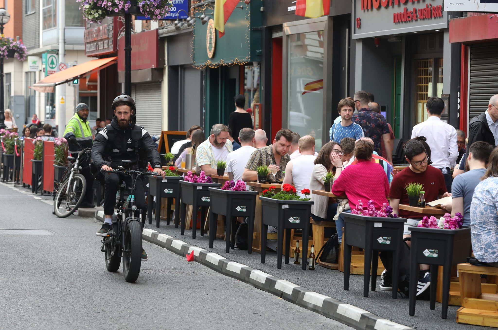 People enjoying food and drink on Dublin's Capel Street on the first Saturday of outdoor dining in June 2021