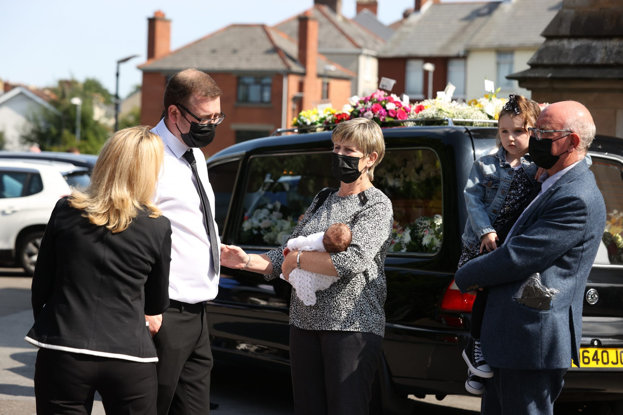 Josh Willis with his new-born daughter Eviegrace, being carried by a relative (name not known) after the coffin of Samantha Willis (nee Curran) was taken from St Columb's Church in Derry, after her funeral