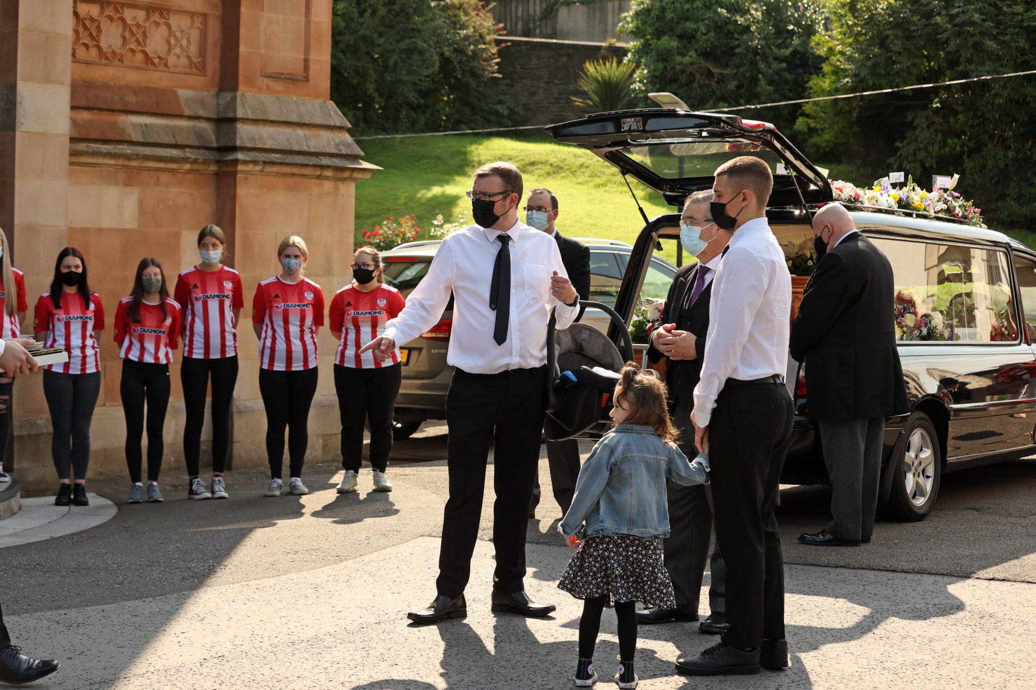 Josh Willis with his family at his wife Samantha's funeral in St Columb's Church in Derry