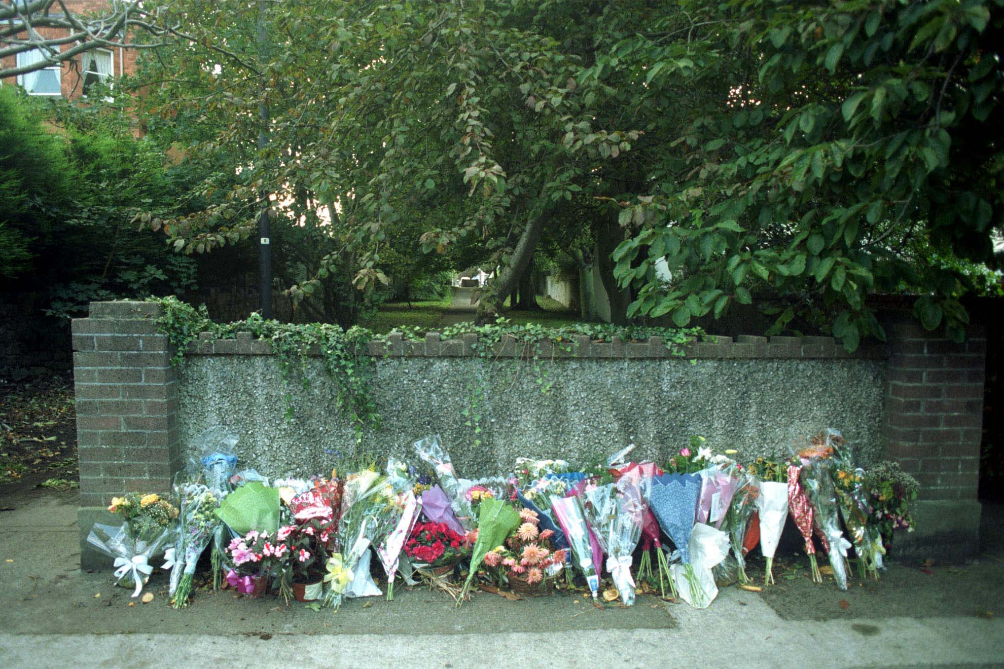 Flowers are seen in Dún Laoghaire where Raonaid Murray was murdered in September 1999.