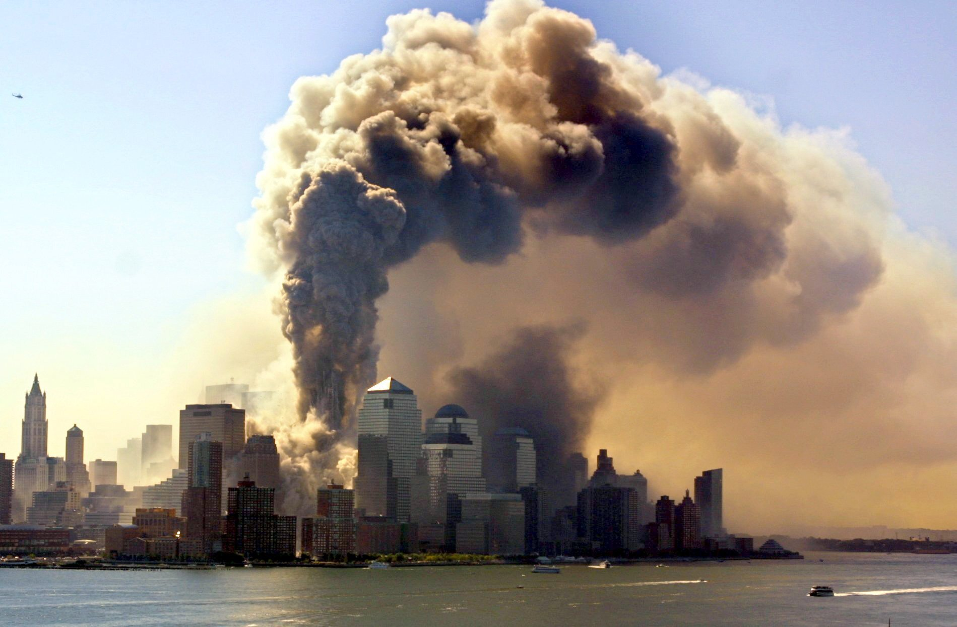 Both towers of the burning World Trade Center in New York collapse after the attack on September 11, 2001