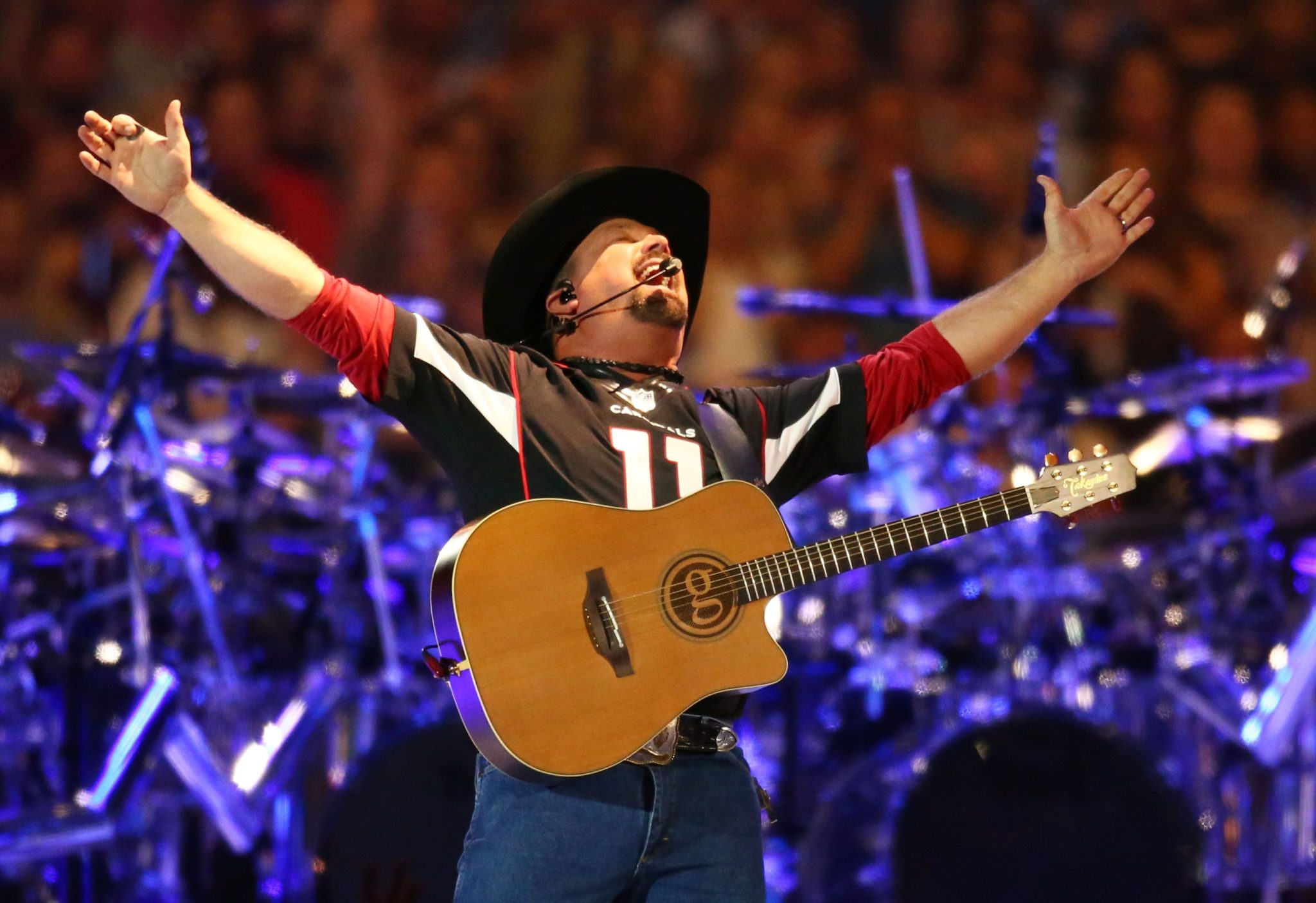 Country music legend Garth Brooks performs to over 75,000 fans, the largest indoor concert crowd ever in Arizona at State Farm Stadium