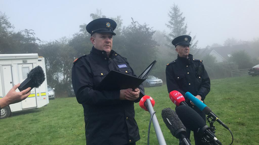 Inspector John Fitzgerald speaking to media at the search site