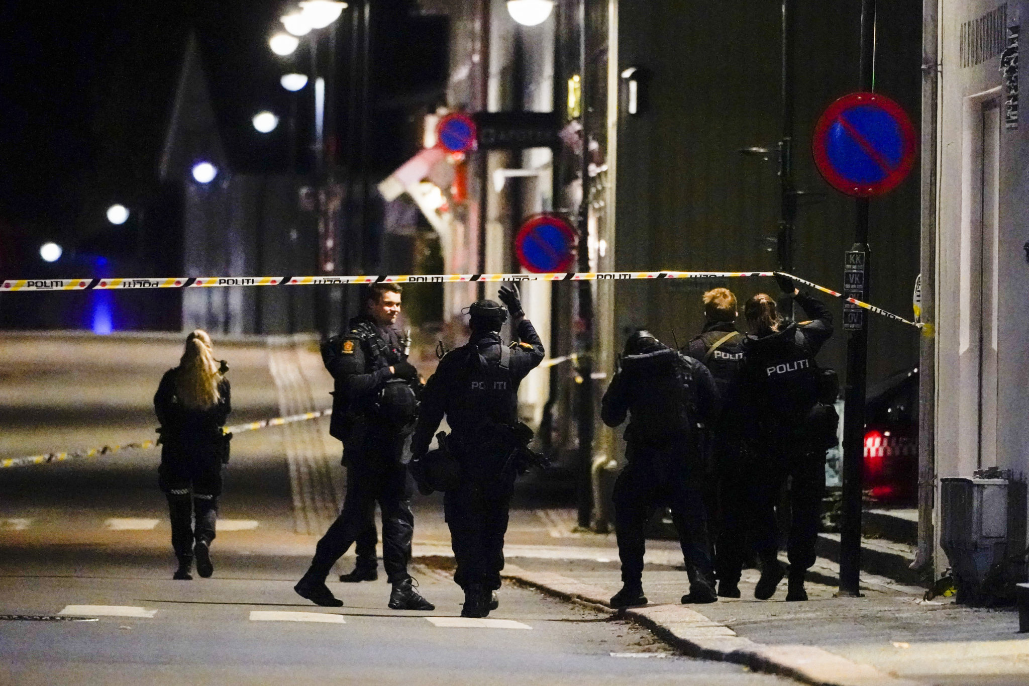 Police examine the scenes of the attack in Norway